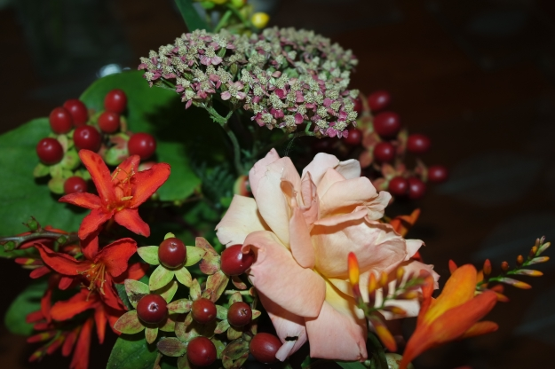 Orange rose, crocosmia, hypericum, achillea