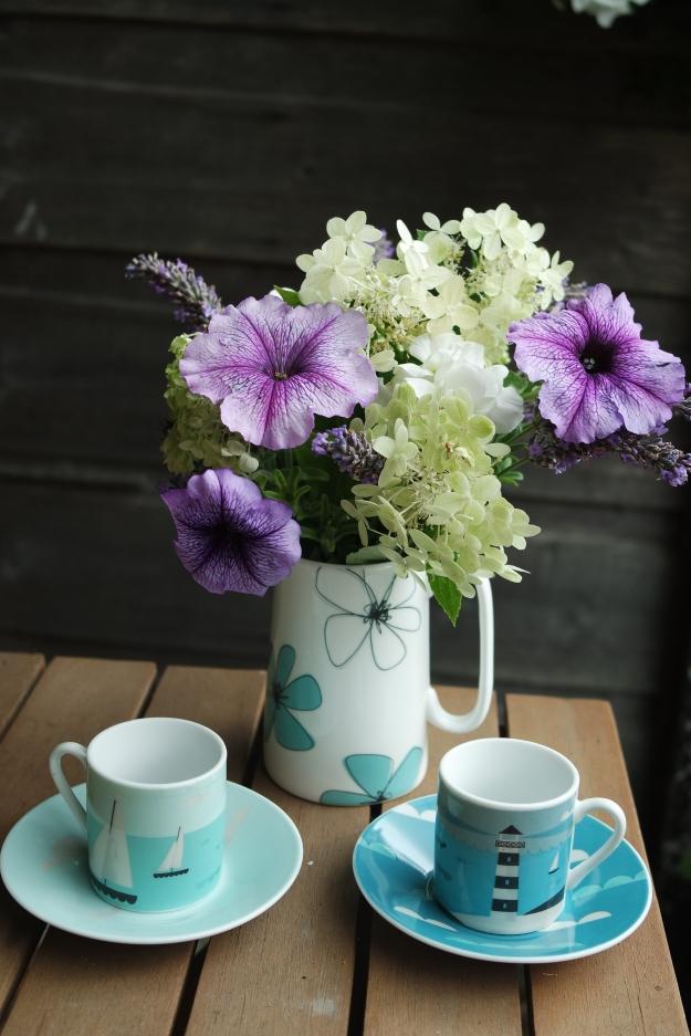Hydrangea, petunia, pelargonium and lavender. Jug: Amy Louise Clarke ceramics Espresso cups: Magpie