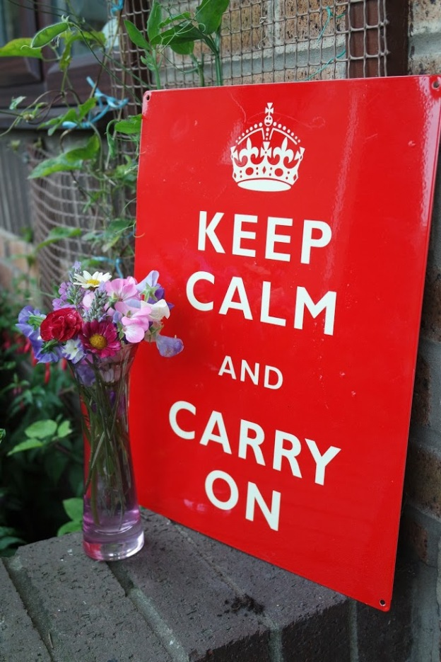 Red keep calm and carry on sign pink vase flowers