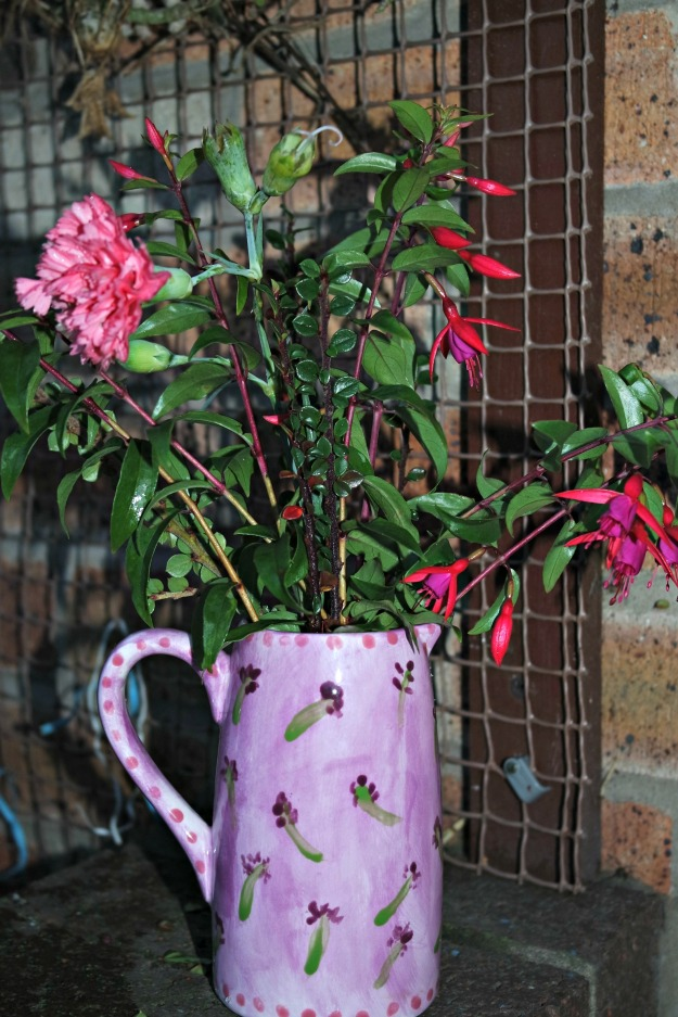 pink and purple fuchsia, pink dianthus and cotoneaster in hand painted lavender pattern vase